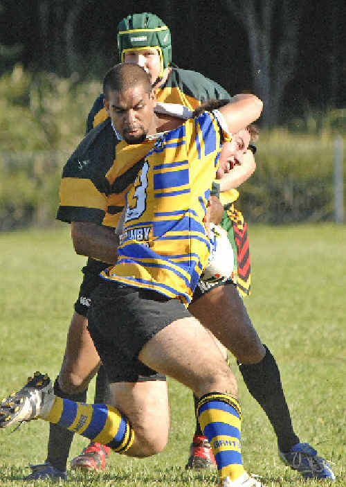 Mullumbimby's Grant Cooke is tackled by Northern United's Marshall Leisha in Lismore on Saturday.