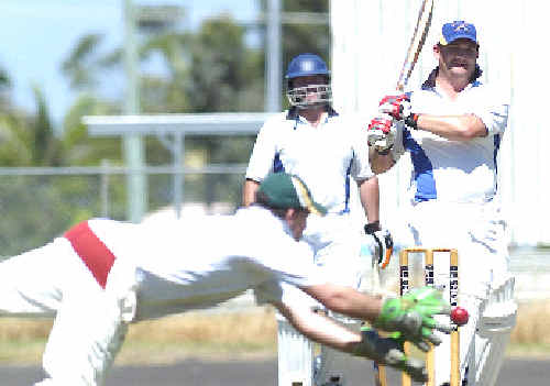 Casino Cavaliers wicketkeeper Todd Summers stretches to catch Marist Brothers batsman Joe Allen in the LJ Hooker League final at the weekend.