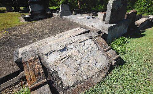 Mindless vandals desecrate 20 historical headstones.