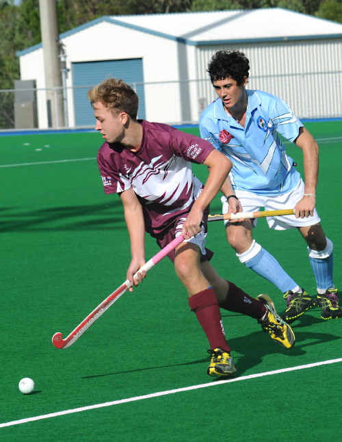 Jordon Warhurst evades a Brothers player on Saturday in the Heat's 5-0 loss to Brothers.