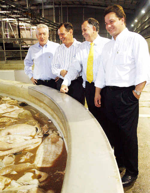 CEO of Swifts Australia Iain Mars (left), Mayor Paul Pisasale, Speaker of the House John Mickle and Wesley Baptista the President and CEO of Swifts USA inside the new $22 million hide salting facility at Dinmore.