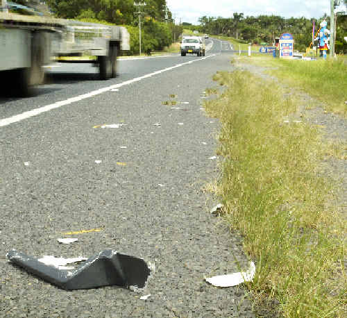 Struck out: Debris left at the scene where a man was hit by a truck on the Pacific Highway near Knockrow on Sunday night.