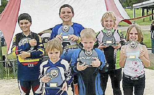 Members of the Gympie BMX Club to have successfully completed the Southern Zone Shootout Series, the final round of which was held in Gympie, show off their trophies. A 'Come and Try Day' was held at the weekend to allow newcomers to the sport a chance at hitting the track.