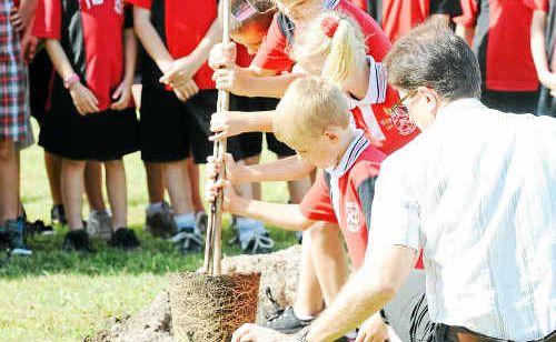 Gooburrum State School students prepare to plant a tree in memory of Trinity Bates.