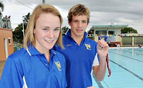 Putting in the hard work during training is paying off for Gympie Gold Fins swimmers Katie Connolly and Scott Gear.