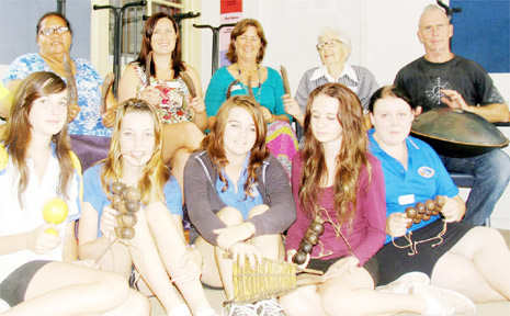 Shakin' All Over – seniors and Mullumbimby High School students shook, clapped and rattled a variety of percussion instruments, both traditional and innovative to follow the lead of Greg Sheehan (far right), at an intergenerational event to celebrate Seniors Week.