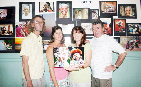 Travel writer and organiser of the photographic competition Kim Wildman (second, right) holds the winning photo. She is pictured with judges (from left) Jeff Dawson, Lisa Sharpe and Michael Malloy.