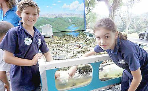 Rosebank Public School students Indigo Shand (left) and Shannon Schulzeck with the interactive catchment management model.