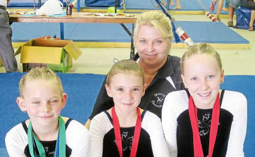 Departing Warwick Gymnastic Club coach Jo Warry with Samantha Pearson, Madison Ammenhauser and Britany Casey at the Beaudesert