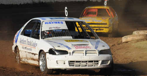 Close call: Mitchell Haynes (front) and Brayd Stephenson fought a close battle in the opening heat of the juniors at Grafton Speedway last month.