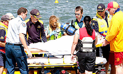 A jet skier is treated after being hit by his machine.