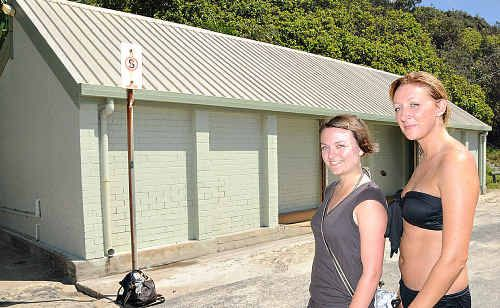 Backpackers Krissy Bresling and Kate Best give a cautious thumbs up to the Rainbow Beach toilet block but only on a quiet day.