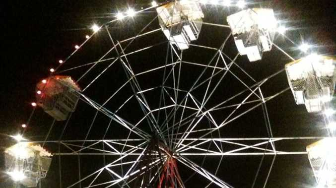 The ferris wheel at Bluesfest after the accident. There is a gap where the ferris wheel car carrying the three girls fell from.