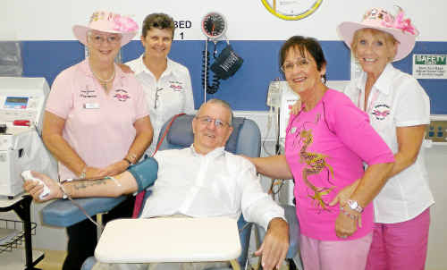 Ray Guthrie makes his 666th plasma donation with Dragon Abreast Gold Coast members Helen Wilson, Lorie Heaton, Fay Henderson and Sue Clackett.