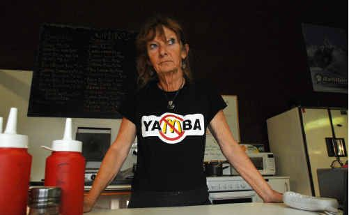 Part owner of Smoko's Snack Bar in Yamba, Cate Murphy, is concerned that she may have to shut up shop if McDonald's is successful in its application for a 24-hour fast-food restaurant in Yamba's Treelands Drive.