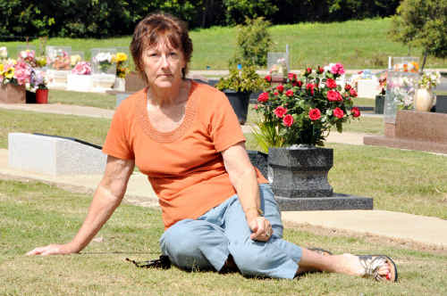 Jean Fisher wants to mark her husband's grave with a granite base like the one pictured (right).