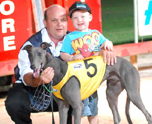 Darryl Armfield and his son with Road Toll ($4.70), which won the Maiden Stake (420m).