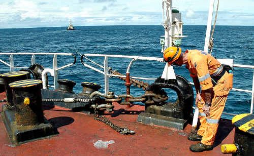 A member of the Svitzer salvage team inspects the line connected to the tug, which is helping to keep the Shen Neng 1 in place.
