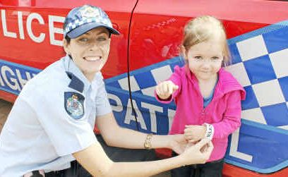 Senior Constable Sarah Ellis tags two-year-old Emily Day in case she gets lost at the Warwick Show.