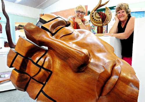 IMPRESSIVE: Woolgoolga Art Group members Jenny Storum and Marilyn Bloor with John Van Der Kolk's sculpture Sentinel No 7.