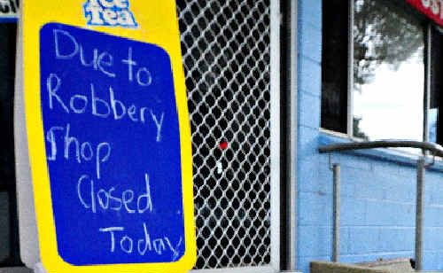 THE SIGN SAYS IT ALL: The quiet scenes at Mylestom General Store yesterday were in stark contrast to the dramatic events of Wednesday.