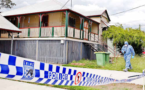 Police forensic staff outside the Dudleigh St, Booval, home of Amanda.