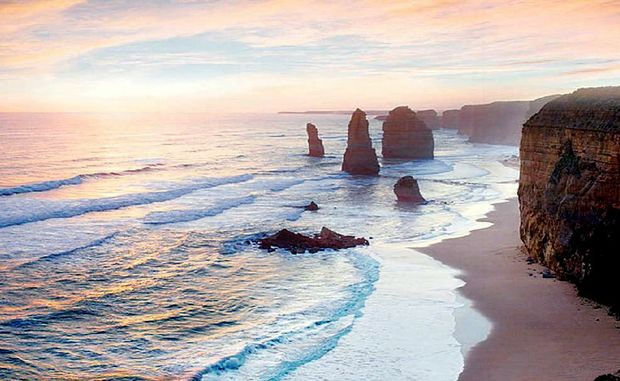 The sun sets over the 12 Apostles on the Great Ocean Road.
