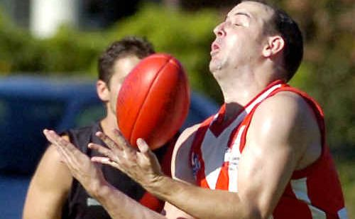 The Lismore Swans' Jarred Rose takes a mark against the Ballina Bombers in the Summerland AFL game at Mortimer Oval, Lismore, on Saturday.