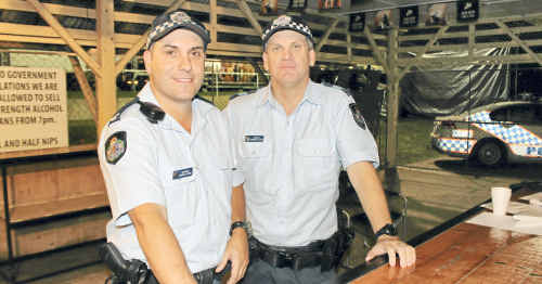 Warwick Police Constable Darren Adams and Sergeant Cameron Slater at the Warwick Show on Saturday night.