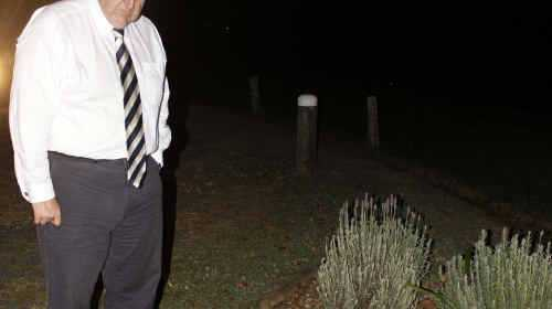 EVASTATION: NSW Opposition leader Barry O'Farrell looks over the Cowper bus crash memorial site.Photo: Marcus Greig