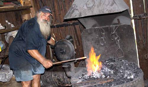 Blacksmith Owen Burgemeister demonstrates his craft at the steam festival.