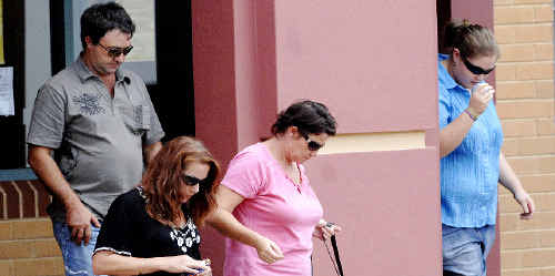 The parents of Lyndsey Pankhurst – her father in a grey shirt and her mother wearing a pink top – and two friends leave the Lismore Courthouse after yesterday's court proceedings.