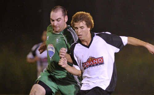 Clinton player Brendan Kanofski (left) and Central player Andrew Maynard in a tussle over the ball.