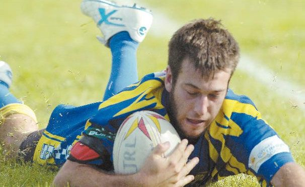 HE'S IN: Chris De Giusti scores for Marist Brothers against Tweed Coast.