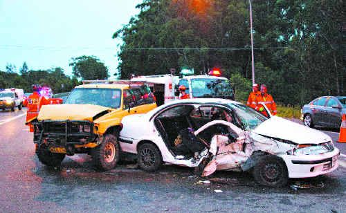 The SES had to cut a woman free after this two-car smash at the intersection of the Pacific Highway and Moonee Beach Road.