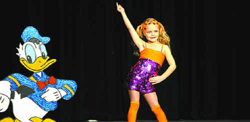 A young performer struts her stuff at the 2009 Coffs Harbour and District Eisteddfod.