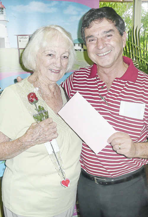 Agnes Water Visitor Centre volunteer Liz Aitken, who has just turned 90, with GAPDL Chairman Peter Corones.