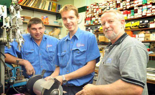 Lindsay Kliendienst, centre, with his tutor Mark Nixon, right, and Grafton Locksmiths owner Neil Hayton.