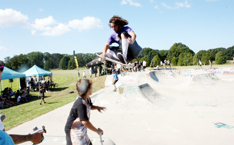 A skater gets airborne while another ducks for cover during an expression session at the annual skate competition RUKKUS at Mullumbimby on Saturday