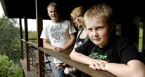 Ashley Mackinnon at their Wilsons Creek home with his two children Rebecca Kinsella, 16, and Alec Mackinnon, 10.