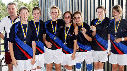 The under-14 girls FNNSW futsal team, comprised entirely of players from the Goonellabah club, reached the grand final with just six players. The team is (from left) James Watson (coach), Serena Mangan, Keoni Tagget, Tilly McGeary, Riley Hore, Thalia Brice (goal-keeper), Shannon Collis, and Chelsea Mangan, sporting a cast on her broken wrist.
