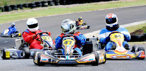 Tamworth's Allan Paull (No 47) leads Lismore Kart Club's John Oakes (No 54) in round 2 of the Northern Challenge held at Grafton on Sunday.