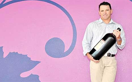 Purple Palate Sunshine Coast director Darren Naylor holding a six litre 'Methuselah' bottle at the new bottleshop at the Duporth Tavern.