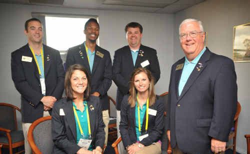 San Lee Sunrise Rotary Club's Leslie Cox with his group study exchange team from North Carolina at the South Grafton Ex-Servicemen's Club for the Rotary Conference.