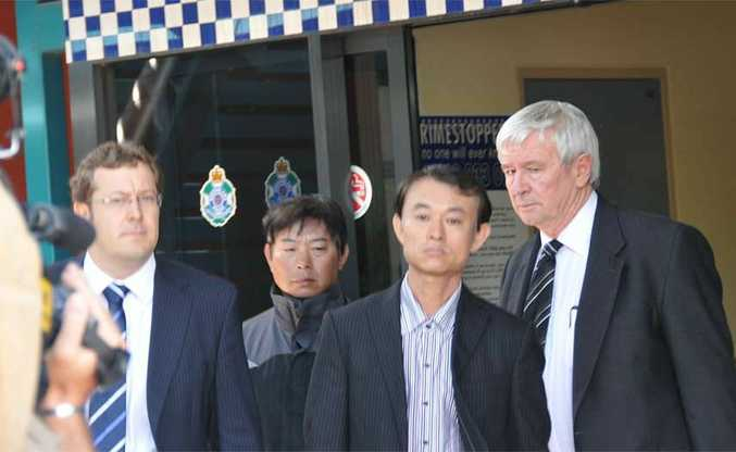 Solicitor Matthew Hockaday, Shen Neng 1 chief-officer-on-watch Xuegang Wang, Captain Jichang Wang and barrister Tony Glynn leave the city's courts precinct yesterday.