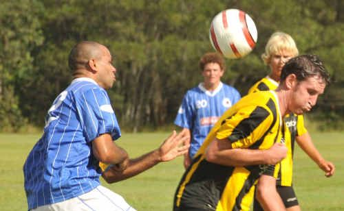 Yamba's Dan Griffin (right) goes in tough.