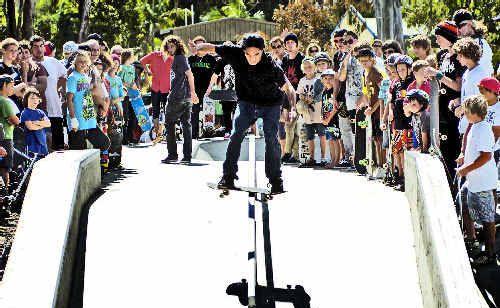 Railway: Ben Hughes makes a rail slide at the new skate park.