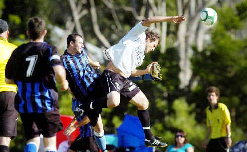 When the two worlds collide: Byron Bay's Jordy Campbell (right) almost collides with a Bangalow player in their match at Bangalow on Saturday.