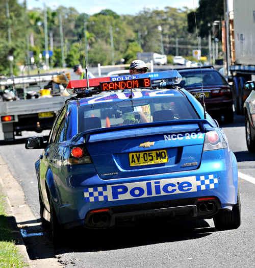 NSW police stop motorists for random breath testing.