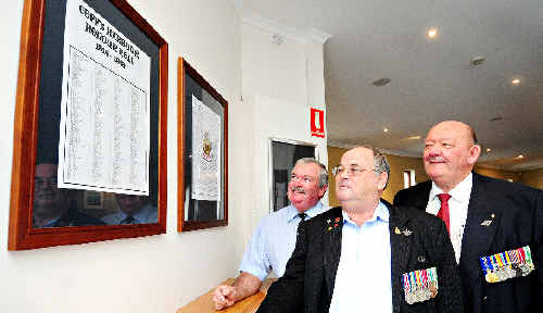 Mayor Keith Rhoades, RSL Sub-Branch president Bob Payne MM and former Sub-Branch president David Doyle hanging the honour roll at the Jetty Memorial Theatre.